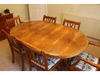 Yew Dining Room Table with 6 chairs including 2 carvers