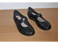 Pair of Clarks ladies black flat shoes size 5½ extra wide.
