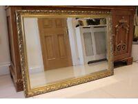Antique gold-framed large mirror