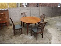 Round Extendable Dining Table with Chairs