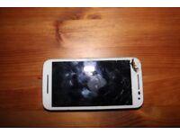 Motorola Moto 3G. Broken screen but works fine.