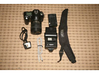 Nikon D50 with 18-70 Lens + Flash.