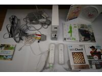 Nintendo Wii console plus Wiii Fit, various games and controls