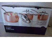 Brand new, unopened box, luxury copper-bottomed saucepan set. Duplicated present