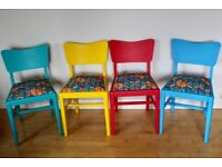 Four vintage 1970s dining room chairs chalk painted and upholstered African wax print fabric