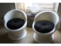 Groovy white plastic bucket chairs for home or garden. Sturdy and well made. Storage in base.
