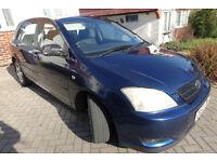 Blue Toyota Corolla 5 door hatchback Nov 2002