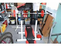bench, stands, weights, & case of ladies dumbells,