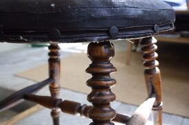 Vintage wooden stool with turned legs
