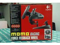 Excellente Logitech MOMO racing force feedback wheel for PC/Playstation