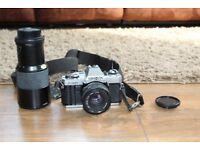 Minolta X300 35mm camera with lenses