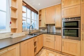 A lateral three double bedroom flat on the fourth floor in a portered block on Melbury Road