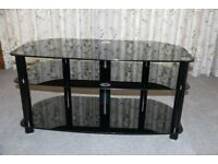 TV Stand in black glass, in as new condition
