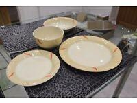 BEIGE / CREAM 26 piece DINNERWARE with RED & DARK BEIGE PATTERN ON RIM