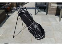 Set of golf clubs with new carry bag.