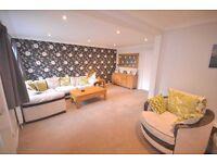 Corner sofa, swivel snug chair, footstool & pattern cushions