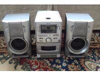 CD , RADIO , AND TAPE MUSIC SYSTEM