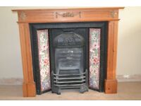 cast iron fireplace with tiled inset and solid pine surround.