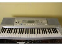 Casio (CTK-810) keyboard with stand for sale. Quality keyboard with theory books.