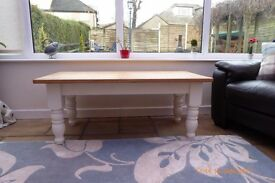 "pine coffee table in very good condition,oiled top and clotted cream base measures 4ft long 19"" ht"