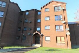 A one bedroom first floor flat within a modern development in Paisley