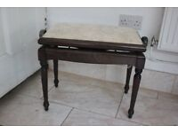 Piano stool with seat adjusting mechanism .