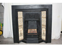 Cast iron fireplace with beautiful tiling and wooden surround
