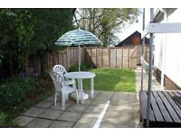 Holiday Chalet Bransgore, well-behaved dogs welcome. Own fenced private garden,secure parking,wi-fi
