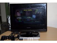 """Play Station 2 slim silver and 11 Play Station 2 Games and Technika 15"""" HD Ready TV"""