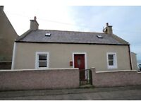 Cosy holiday cottage over looking the expanse of the Moray Coast