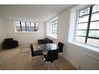Furnished 1 bed loft style apartment, warehouse conversion, on canal, walk to Canary Wf & station