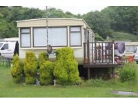 Porthkerry 2 bed static caravan includes all contents so ready to occupy: Pools, Café, Club on site