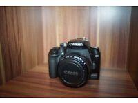 Canon 1000d DSLR + 50mm 1.8 lens