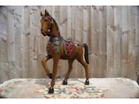 Hand carved figure of horse in hard wood