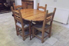 Extendable Dining Table - Round, but becomes oval when extended (Chairs NOT Included)