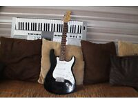 A ENCORE BLACK & WHITE STYLE STRAT GUITAR IN GOOD CONDITION