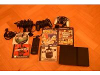 Playstation 2 with 5 games, two controllers and remote control