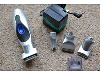 REMINGTON PG200C TITANIUM PERSONAL GROOMER / TRIMMER 4 INTERCHANGEABLE HEADS