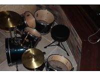 Ashton navy/blue junior 5 piece drum kit complete with stool and sticks.