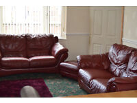 Red 3 piece leather suite with footstool