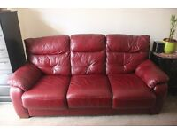 An elegant 3-4 seater leather sofa bed, burgundy in color