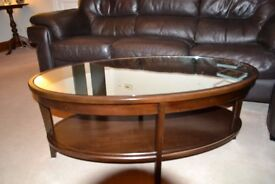 M & S glass topped coffee table in mahogany