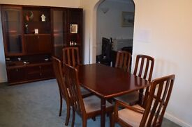 Dining table, 6 chairs and display cabinet in mahogany.