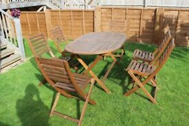 Outdoor wooden table and 6 chairs with seat covers £130