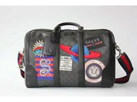 Gucci Night Courrier soft GG Supreme carry-on duffle