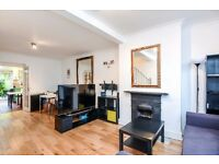 A charming, split level two bed house offering a double volume reception room and a private garden.