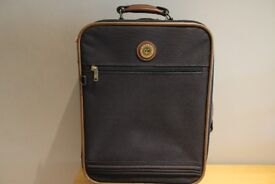 A sturdy, wheeled Carlton suitcase in very good condition. Within most airline hand luggage rules