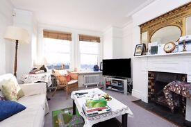 Spacious & bright 2 bed flat set in a well-maintained red brick mansion block. Cambridge Road SW11