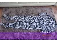 Zebra Onesie. Size UK 6-8. Great condition. £4. Torquay or posting is available.