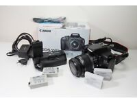 Canon EOS 550D with 18-55mm lens and battery grip - excellent starter kit or backup camera